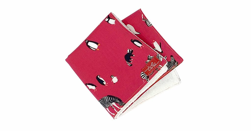 pink washcloth with penguins and zebras