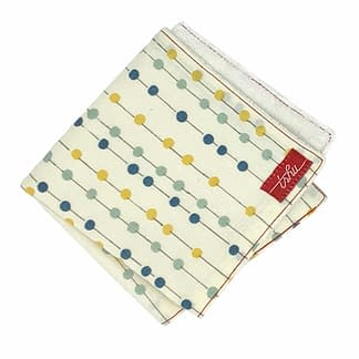 ivory bamboo washcloth with yellow and blue dots